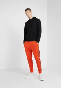 HUGO - DRAPANI - Trainingsbroek - dark orange - 1