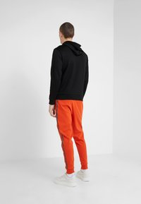 HUGO - DRAPANI - Trainingsbroek - dark orange - 2