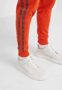 HUGO - DRAPANI - Trainingsbroek - dark orange - 4