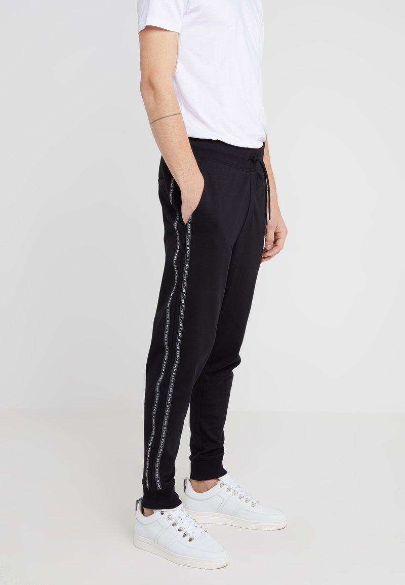 HUGO - DRAPANI - Spodnie treningowe - black