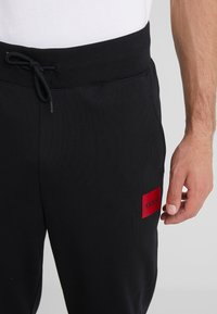 HUGO - DAKARTA - Pantalon de survêtement - black - 3