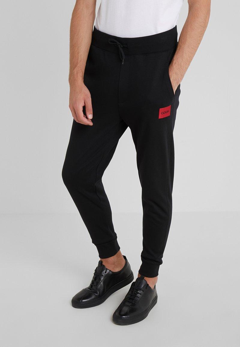 HUGO - DAKARTA - Tracksuit bottoms - black
