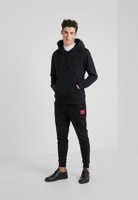 HUGO - DAKARTA - Pantalon de survêtement - black - 1
