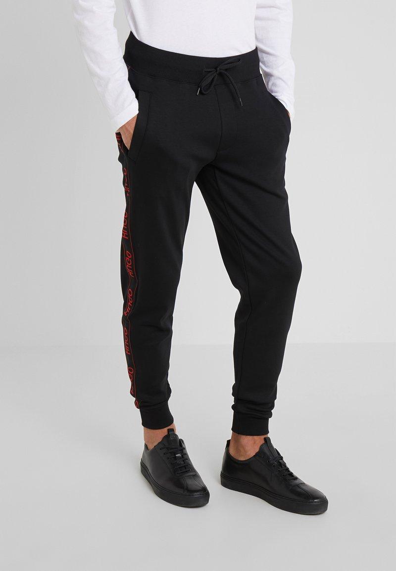 HUGO - DASCHKENT - Pantalones deportivos - black