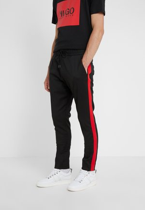 ZANDER - Trousers - black/red