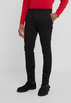 HELDOR - Pantalones chinos - black