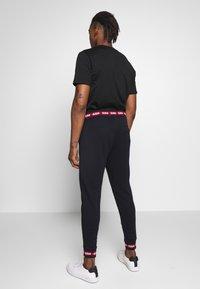 HUGO - DOAK - Pantalon de survêtement - black - 2