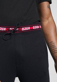 HUGO - DOAK - Pantalon de survêtement - black - 4
