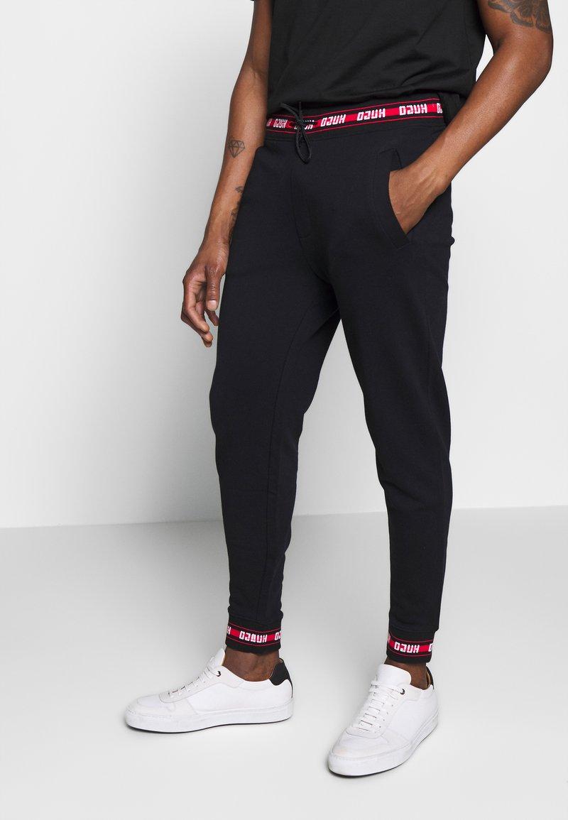 HUGO - DOAK - Pantalon de survêtement - black