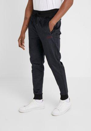 DECHI - Teplákové kalhoty - black