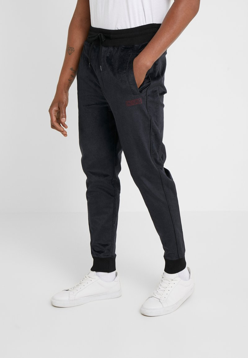 HUGO - DECHI - Tracksuit bottoms - black