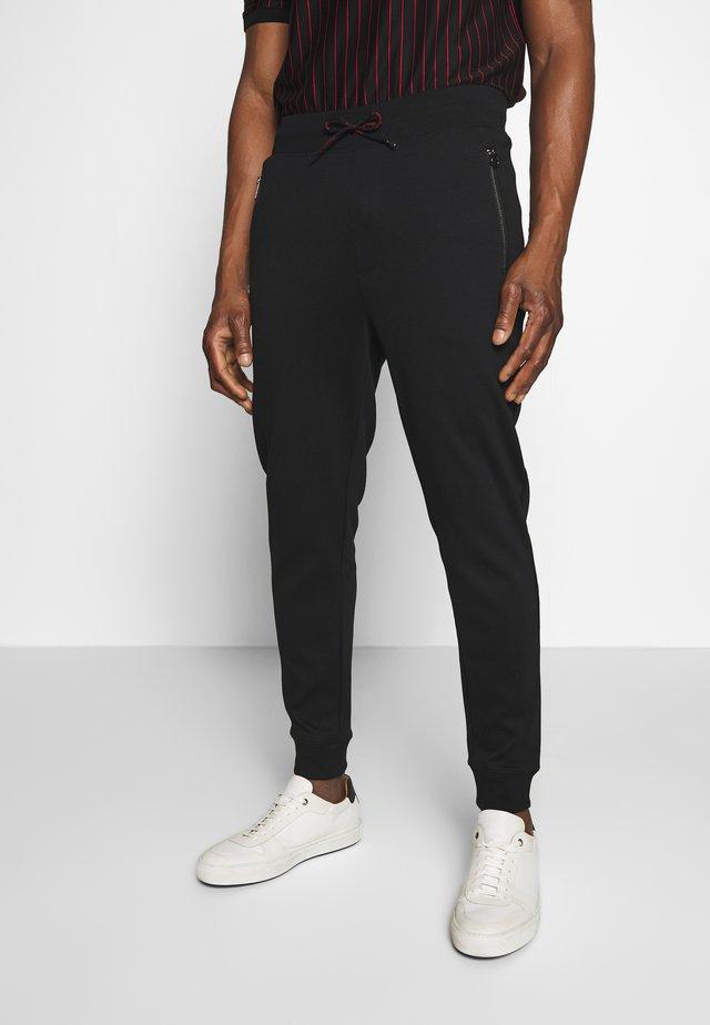 DEASTY - Pantalones deportivos - black