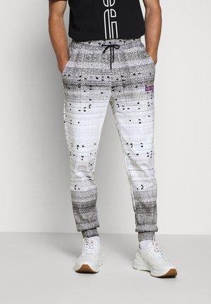 DONACO - Pantalon de survêtement - white