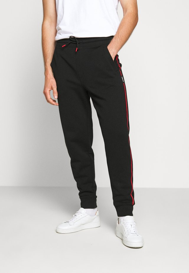 DOAKY - Tracksuit bottoms - black