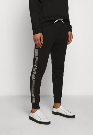 DAKY - Pantalon de survêtement - black