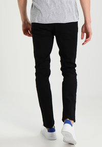 HUGO - Jeansy Slim Fit - black