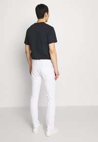 HUGO - Slim fit jeans - white