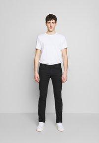 HUGO - Jeansy Slim Fit - black - 1