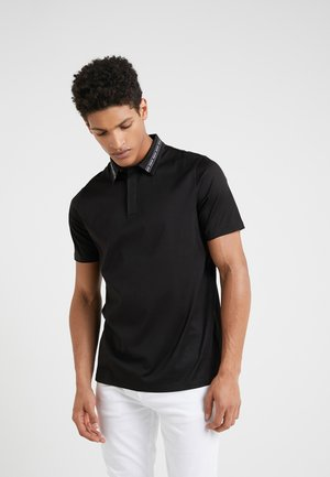 DIVORNO - Polo shirt - black
