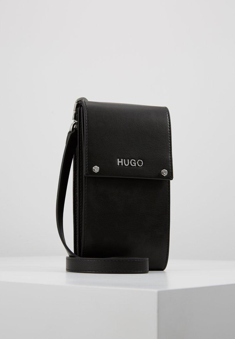 HUGO - LEYTON PHONE CASE - Taška spříčným popruhem - black