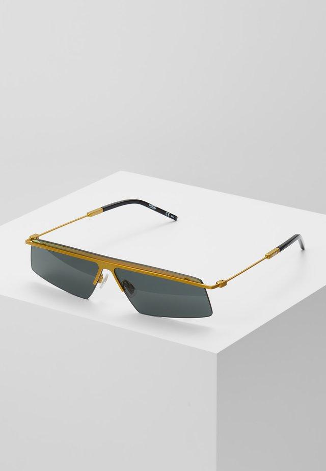 Sonnenbrille - gold -coloured