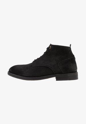 MORRIS - Šněrovací kotníkové boty - black