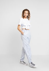 Hummel Hive - HMLDIANA PANTS - Pantalones deportivos - gray dawn - 1