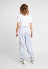Hummel Hive - HMLDIANA PANTS - Pantalones deportivos - gray dawn - 2