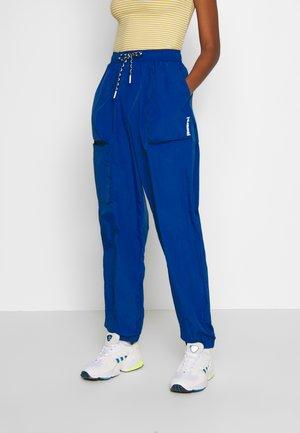 STORM OVERSIZED PANTS - Pantalon de survêtement - mazarine blue