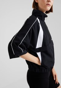 Hummel Hive - HALF ZIP - Windbreaker - black