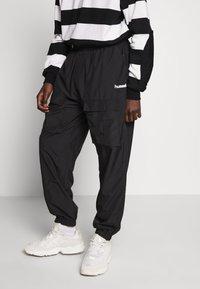 Hummel Hive - OVERSIZED PANTS - Pantalones - black - 0