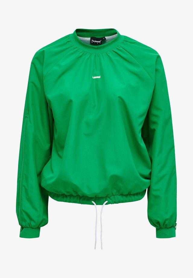 CHRISTAL - Trainingsjacke - bright green