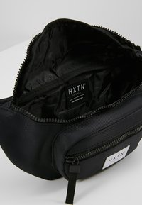 HXTN Supply - UTILITY TRANSPORTER BUM BAG - Bum bag - black - 4