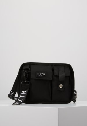 PRIME FACTION CROSSBODY - Riñonera - black