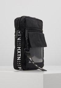 HXTN Supply - UTILITY INDICATOR - Across body bag - black - 4