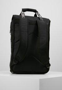 HXTN Supply - UTILITY TRAVELLER - Batoh - black - 2