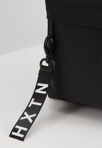 HXTN Supply - PRIME PREMIER - Reppu - black - 2