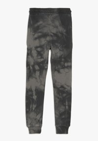 Hype - KIDS ACID WASH - Pantalones deportivos - black