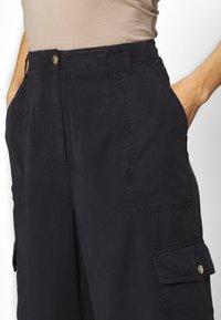H2O Fagerholt - READY TO WEAR PANTS - Trousers - black - 5
