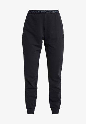 BRYAN - Teplákové kalhoty - black