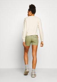 Icepeak - CAROLINE - Sports shorts - antique green - 2