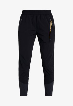 ELYRIA - Trousers - black