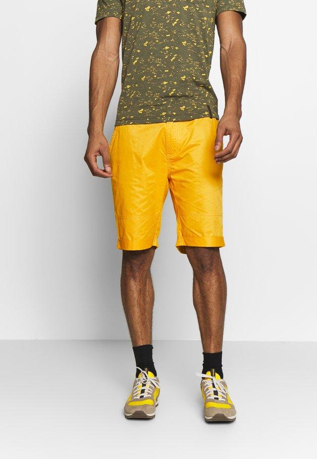 AHLEN - Sports shorts - yellow