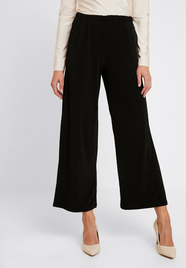 IXLIMA - Trousers - black