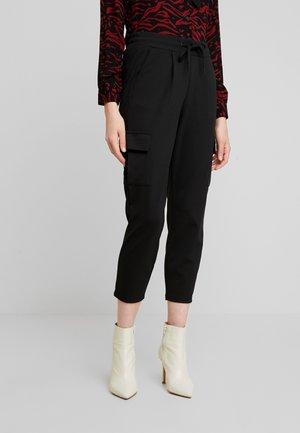 IXKATE - Pantalon de survêtement - black