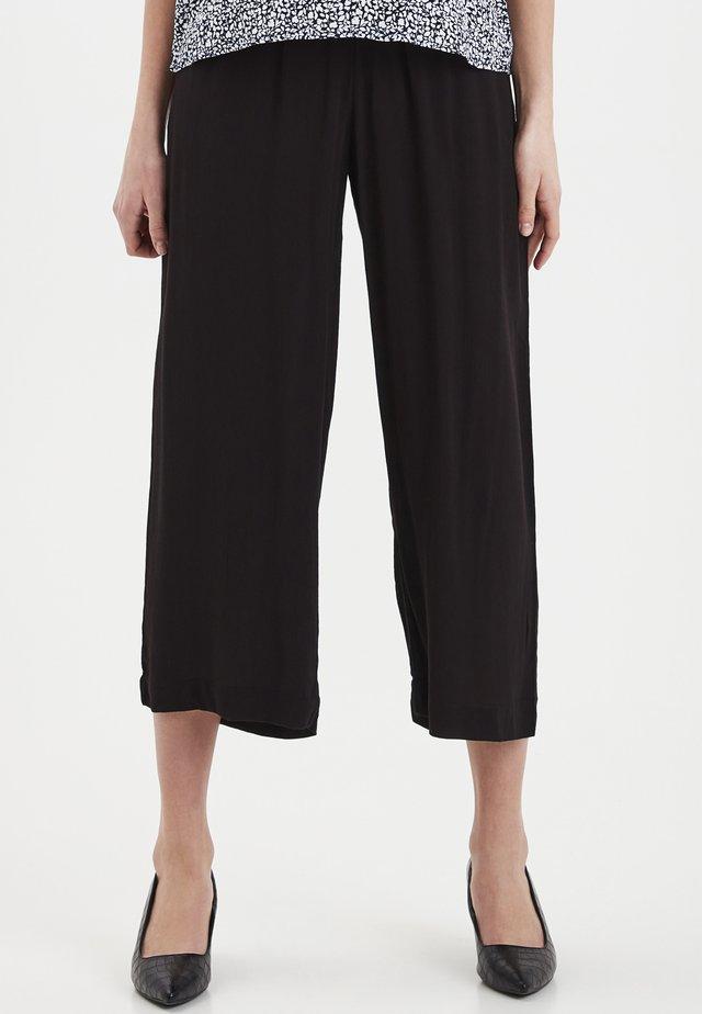 IHMARRAKECH - Trousers - black