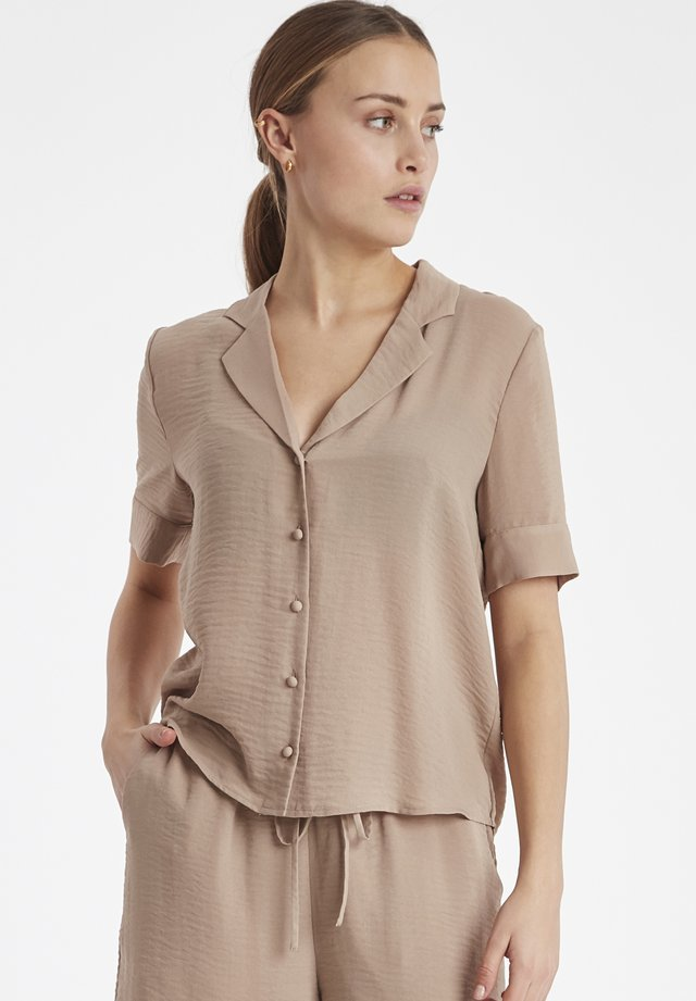 IHHADASA SH - Button-down blouse - natural