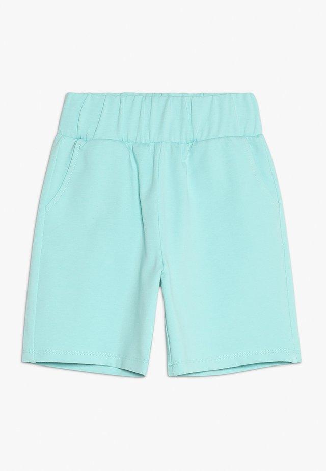 WITH POCKETS - Spodnie treningowe - filtered aqua