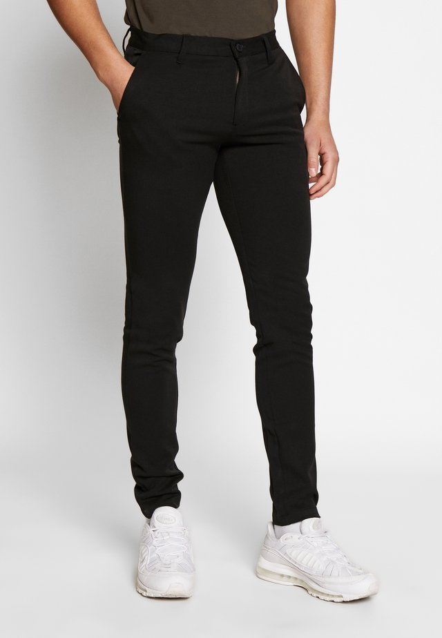 GOLFORD - Trousers - black