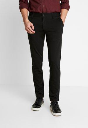 KOLDING - Trousers - black